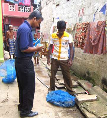 Blue Paw Trust team members catching a street dog for vaccination