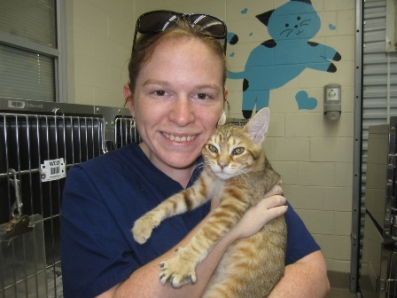Student Lauren Gray with the newest member of her furry family (now named Otis.