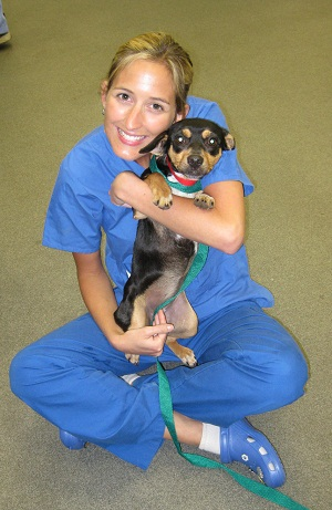 certificate student with shelter dog