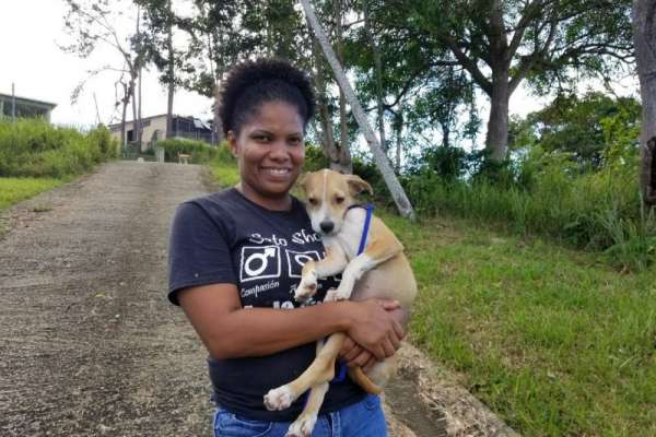 Puerto Rico woman holding cute puppy