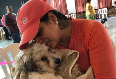 Spayathon for Puerto Rico, woman comforting her dog who is recovering from surgery