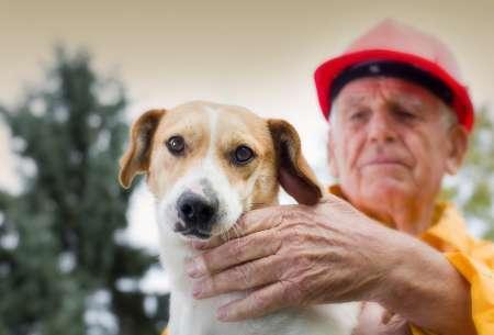 Man rescuing dog in natural disaster