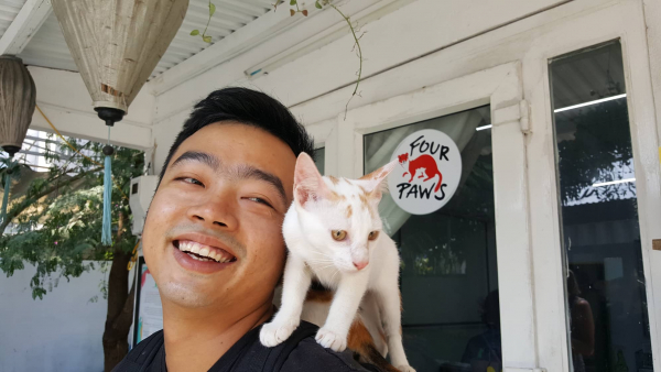 Man with cat on shoulder in VIetnam