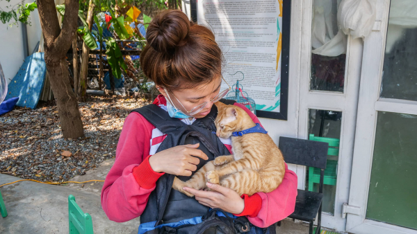 Woman holding cat in Vietnam