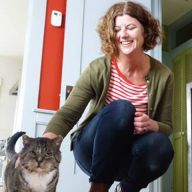 Anne Dunn petting cat